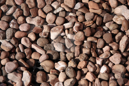 Assorted pebbles stock photo, Assorted brown stone pebbles on the ground by Kheng Guan Toh
