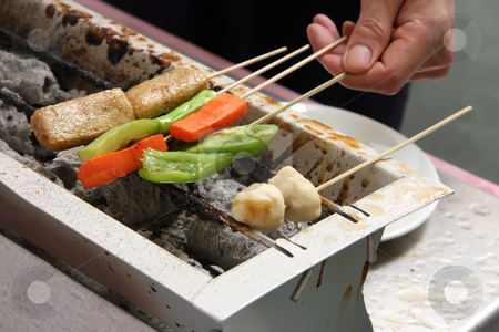Grilling food stock photo, Man's hand grilling skewered meat and vegetables by Kheng Guan Toh