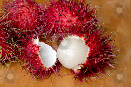 Rambutan fruit stock photo, Rambutan fruits tropical asian fruit on wooden background by Kheng Guan Toh