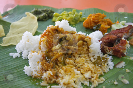 Indian banana leaf stock photo, Traditional indian banana leaf meal rice and curry by Kheng Guan Toh