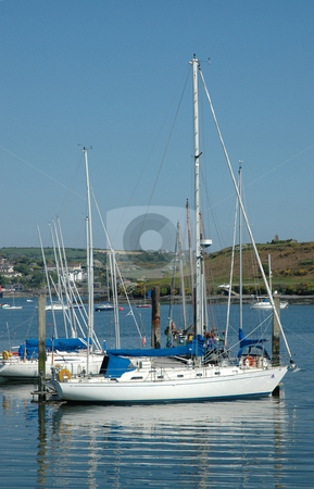 Sailing Boat in Kinsale Harbour, Cork stock photo, Starboard shot of a Sailing Boat in Kinsale Harbour, Cork on a bright summer day by Simon Jeacle