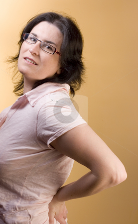 Young woman with pink shirt stock photo, Young woman by Ivan Montero