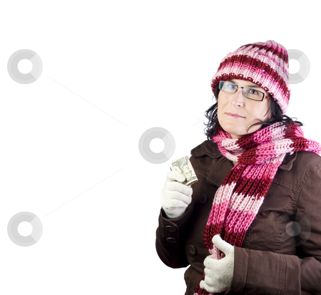 Winter shopping girl stock photo, Adult woman thinking about what to buy holding dollar bills by Ivan Montero