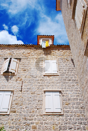 Old stone town in Montenegro - Budva stock photo, Old stone house exterior in Budva, Montenegro by Julija Sapic