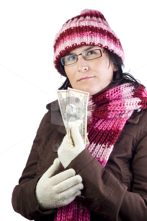 Woman with dollar bills stock photo, Adult woman thinking about what to buy holding dollar bills by Ivan Montero