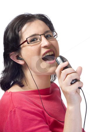 Woman music stock photo, Oung woman listening to a mp3 music device by Ivan Montero