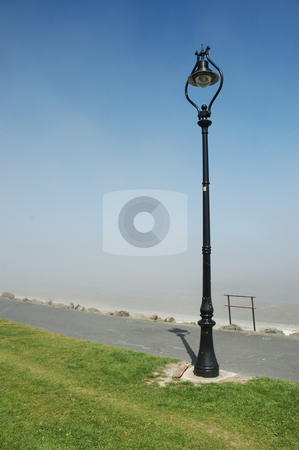 Lampost stock photo, Lampost on Sandymount strand looking over Dublin Bay, Ireland by Simon Jeacle