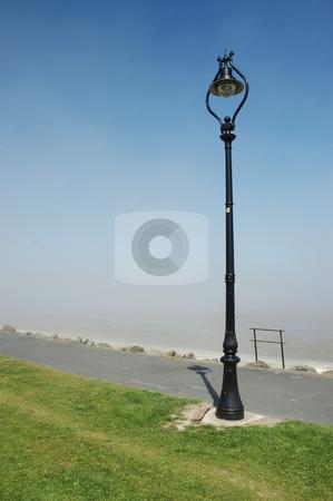 Lampost stock photo, Lampost on Sandymount strand looking over Dublin Bay, Ireland by Simon Jeacle