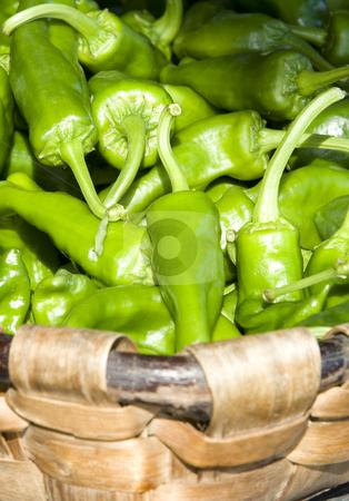 Vegetal green peepers stock photo, Vegetal fresh green peepers inside of a wooden basket by Ivan Montero