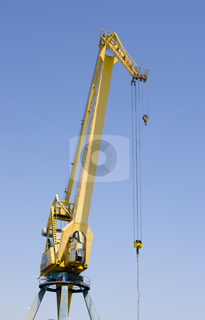 Industry crane stock photo, Construction industry crane heavy  cargo machinery on a blue background by Ivan Montero