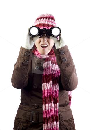 Girl looking through binoculars stock photo, Woman holding and looking through binoculars by Ivan Montero