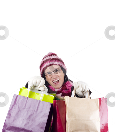 Shopping woman stock photo, Consumerist Christmas girl with bags in a shopping day by Ivan Montero