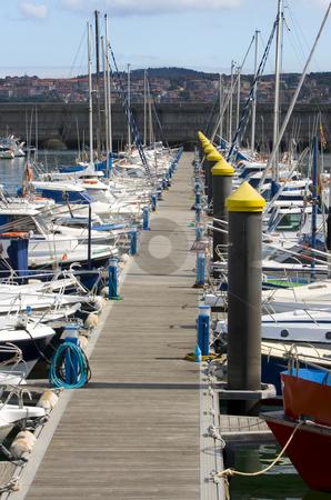 Sport boat transportation stock photo, Boat resting in paceful water in the dock harbor of Santurce near Bilbao by Ivan Montero