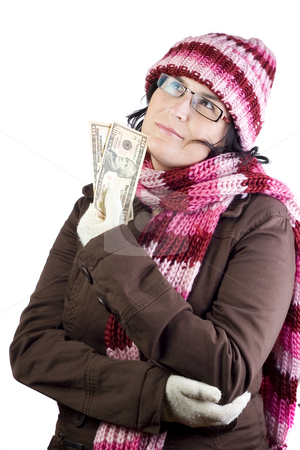 Shopping girl stock photo, Adult woman thinking about what to buy holding a dollar note by Ivan Montero