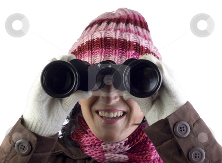 Girl peering through binoculars stock photo, Woman holding and looking through binoculars by Ivan Montero