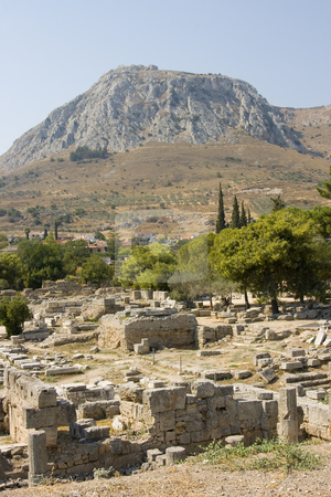 Corinth ancient ruins stock photo, Ancient ruins of the old greek city of corinth in the peloponese by Ivan Montero