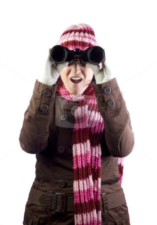 Girl with binoculars stock photo, Woman holding and looking through binoculars by Ivan Montero