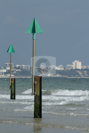 Sandbanks beach,Dorset England stock photo, View across the bay from Sandbanks beach towards Bournemouthwith groyne markers in the foreground by Chris Pole