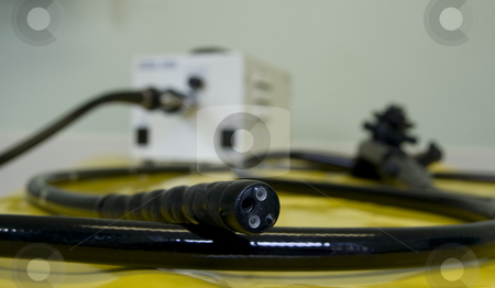 Business end of a medical endoscope stock photo, Tip of a medical endoscope with the rest of the instrument  in the background by Chris Pole