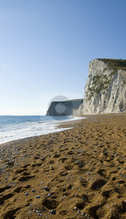 Footsteps on the beach Durdle Door,Dorset,England stock photo, Many footsteps in the shingle on  Durdle Door beach,Dorset,England with the tall chalk cliffs in the distance by Chris Pole