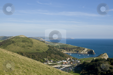 View over Lulworth Cove,Dorset,England stock photo, View over Lulworth Cove,Dorset,England from the high point of the coastal path. Lulworth cove is a useful shelter for small boats and yachts, a popular holiday destination and a part of the Jurrasic coast a World Heritage site by Chris Pole