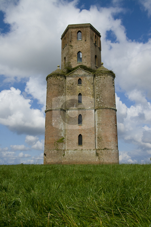 Horton Tower, a folly,Dorset ,England stock photo, Built by Humphrey Sturt in the 1700s Horton Tower is a folly ( a building constructed by wealthy landowners for no useful purpose). It may have been an observatory. Standing on a hill it dominates the surrounding Dorset countryside. more recently it has been restored and has discrete mobile phone antenae attached to it. It featured in a film of Thomas Hardy's novel Far from the Madding Crowd by Chris Pole