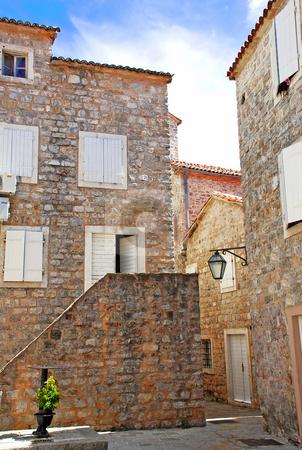 Old stone town in Montenegro - Budva stock photo, Old stone houses exterior in Budva, Montenegro by Julija Sapic