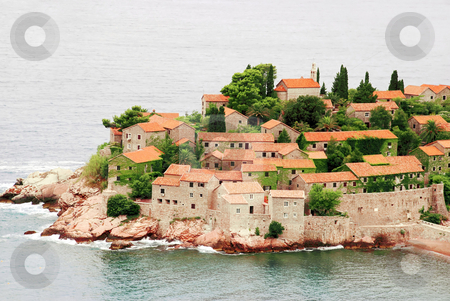 Travel Montenegro stock photo, Island Sveti Stefan in Adriatic sea, stone houses tiled roofs by Julija Sapic