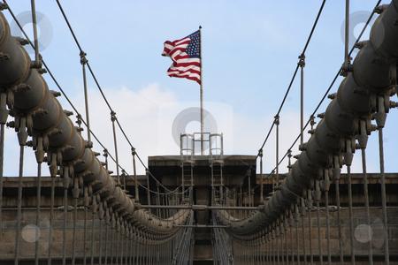 Brooklyn Bridge stock photo, Brooklyn Bridge cables with American Flag by Ryan Bouie