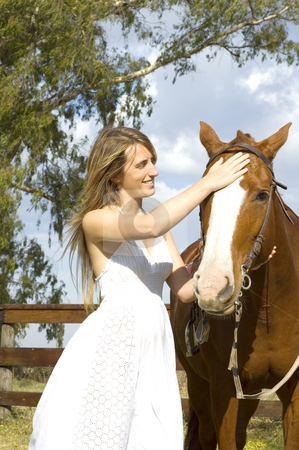 Woman and horse stock photo, A young woman bonding with her horse by Lee Torrens