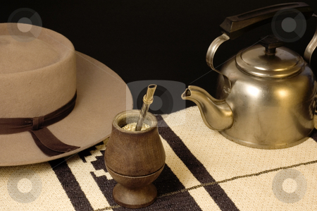 Yerba Mate stock photo, An Argentinean Yerba Mate scene, including a kettle and typical Argentinean hat. by Lee Torrens