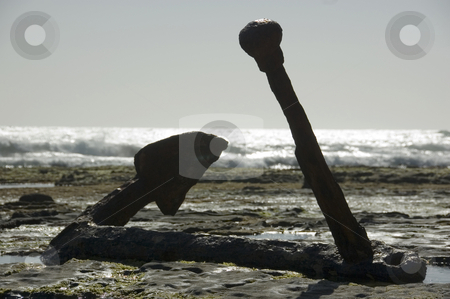 Rusty old anchor of a shipwreck stock photo, A large anchor from a 1800's sailing ship that was shipwrecked on the rocks by Lee Torrens