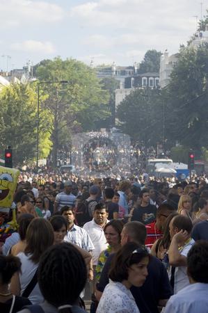Notting Hill Carnival (London) stock photo, People walking towards notting hill carnival parade by Lee Torrens