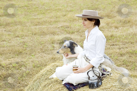 Farm Girl and Dog Relaxing stock photo, A young farm girl and her dog enjoying a relaxing break together by Lee Torrens