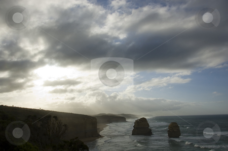 The Twelve Apostles stock photo, A dramatic sky over Australia's natural wonder, The Twelve Apostles. by Lee Torrens