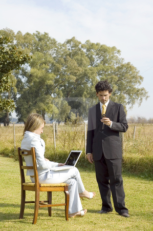 Business Team Working Outdoors stock photo, A businessman and businesswoman working on a rural property. by Lee Torrens