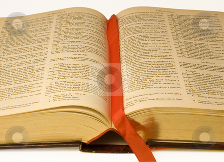 Spanish Bible isolated stock photo, A large open Bible in Spanish language, isolated by Lee Torrens