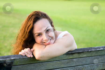 Beautiful woman at the park stock photo,  by Jose Wilson Araujo
