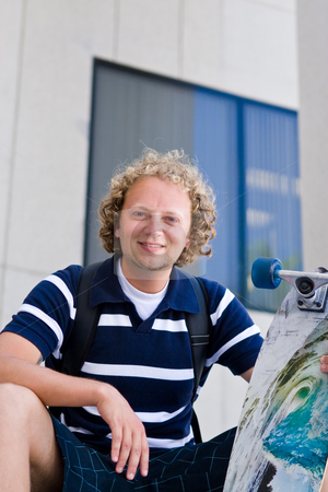 Student with skateboard stock photo,  by Jose Wilson Araujo
