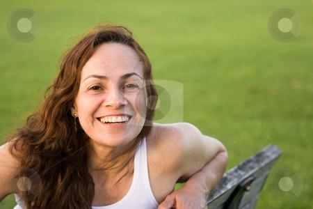 Beautiful woman at the park stock photo,  by Jose Wilson Araujo