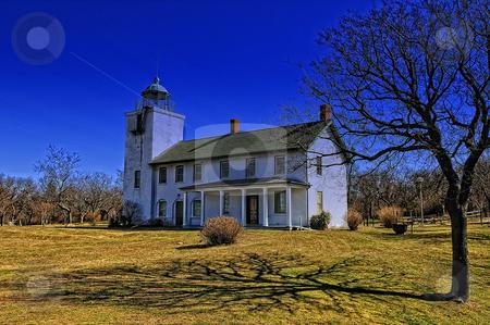 Horton Point lighthouse winter sky stock photo, Horton Pt. lighthouse against blue winter sky by Tim Doubrava