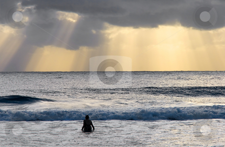 Awestruck stock photo, A swimmer awestruck by this fantastic display of crepuscular Rays off the Sunshine coast just after sunrise. by Mike Dawson