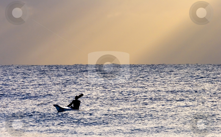 Kayak at Dawn stock photo, A lone Sea Kayak out paddling as a great display of heavenly rays opens up behind them on the Sunshine Coast of Australia by Mike Dawson