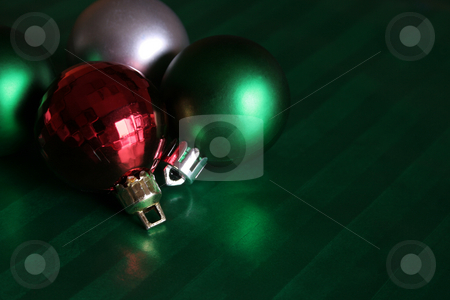 Bauble Collection stock photo, A collection of baubles sitting on green wrapping paper. by Chris Hill