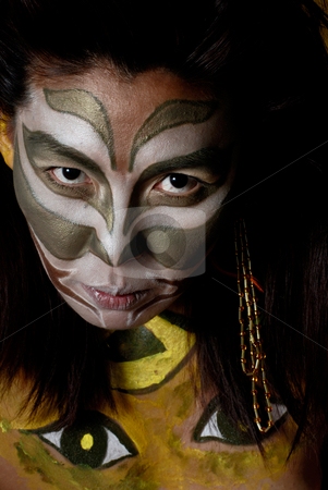 American indian with facepaint stock photo, Stylized amerindian militant drawing on feminine person by Vadim Maier