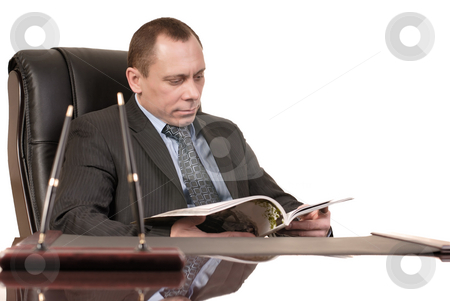 Reading journal stock photo, Man sits with journal at the table by Vadim Maier