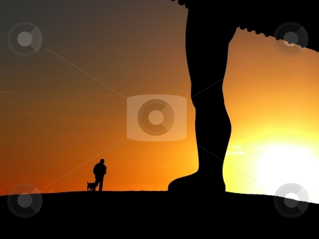 Man and his dog stock photo, Silhouette of man with his dog passing by the Angel of the North sculpture at sunset by Laurent Dambies