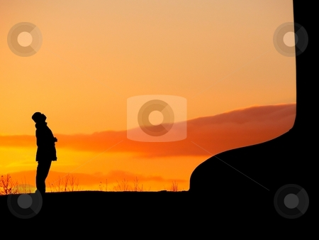 Looking up stock photo, Silhouette of a young man looking up to the Angel of the North sculpture at sunset by Laurent Dambies