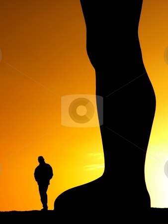 Looking up stock photo, Silhouette of a  man walking by the  Angel of the North sculpture at sunset by Laurent Dambies