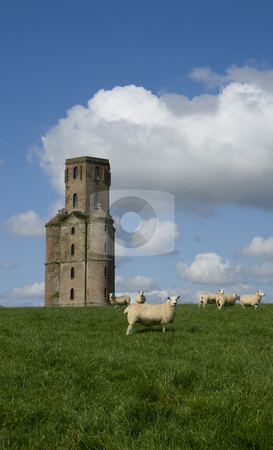 Horton Tower, a folly,Dorset,England stock photo, Built by Humphrey Sturt in the 1700s Horton Tower is a folly ( a building constructed by wealthy landowners for no useful purpose). It may have been an observatory. Standing on a hill it dominates the surrounding Dorset countryside. more recently it has been restored and has discrete mobile phone antenae attached to it. It featured in a film of Thomas Hardy's novel Far from the Madding Crowd by Chris Pole